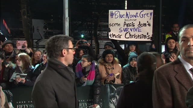 Exteriors of woman holding anti domestic violence placard at Fifty Shades of Grey premiere on February 12 2015 in London England