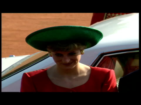 exteriors Prince Charles Princess of Wales Princess Diana arrive in car greeted by officials exteriors Charles receives Guard of Honour interiors...