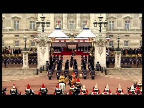 exteriors queen elizabeth ii arrives at buckingham palace in car exteriors queen's cavalry coldstream guards stage setup exteriors queen prince... - state visit stock videos & royalty-free footage