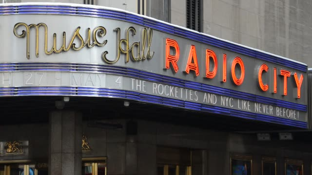 Exteriors shots of Radio City Music Hall venue exteriors and signage in New York US during the day Close up shots of the Radio City Music Hall Neon...