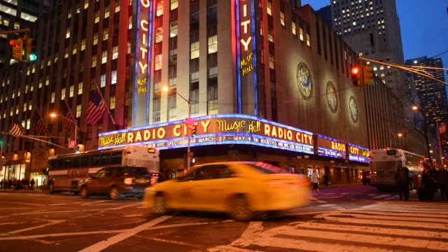 exteriors shots of radio city music hall venue exteriors and signage in new york us at night with the sign lit up close up shots of the radio city... - radio city music hall stock videos & royalty-free footage