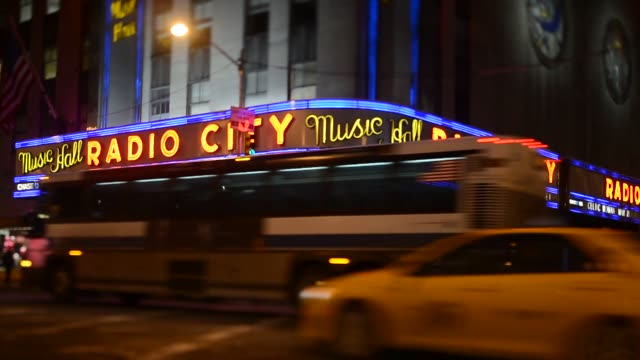 Exteriors shots of Radio City Music Hall venue exteriors and signage in New York US at night with the Sign lit up Close up shots of the Radio City...