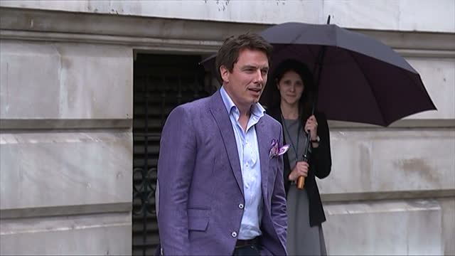 exteriors showing entertainer john barrowman arrive at event posing for press photographers - john barrowman stock videos and b-roll footage