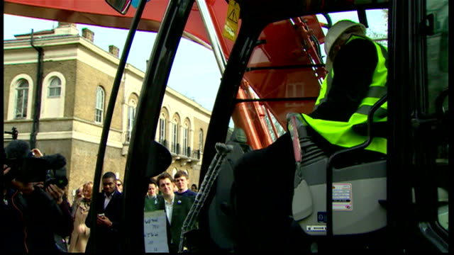 exteriors shows boris johnson mayor of london in earth mover excavator on trip to hospital in tower hamlets on march 20 2014 in london england - bürgermeister stock-videos und b-roll-filmmaterial
