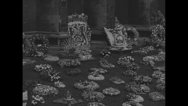 exteriors st george's chapel pan down to hundreds of flowers and wreaths on grounds / vs wreaths / church official greets royal family as they leave... - st. george's chapel stock videos and b-roll footage