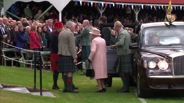 exteriors the queen prince philip and prince charles arrival with meet and greet hand shakes highland games queen prince philip and charles on... - highland games stock videos & royalty-free footage