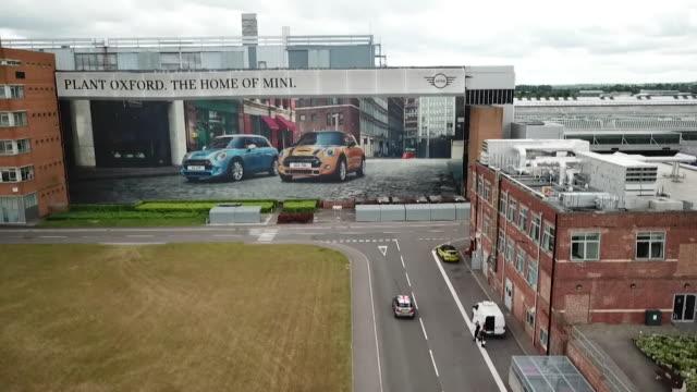 external aerial drone shot of bmw's mini car plant in oxford - 自動車ブランド mini点の映像素材/bロール