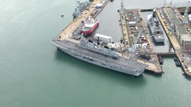 external aerial shots hms illustrious in portsmouth dockyard before setting sail for cougar 13 three royal navy warships set sail for the... - hms illustrious r06 stock videos and b-roll footage