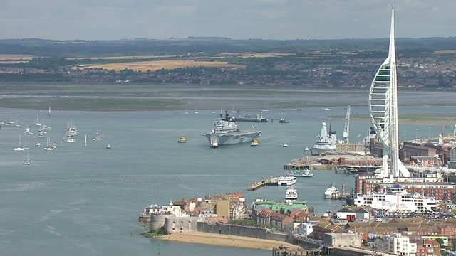 external aerial shots hms illustrious sails past spinnaker tower in portsmouth en route to cougar 13 three royal navy warships set sail for the... - hms illustrious r06 stock videos and b-roll footage