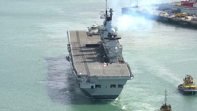 external aerial shots hms illustrious setting sail for cougar 13 from portsmouth three royal navy warships set sail for the mediterranean in what... - hms illustrious r06 stock videos and b-roll footage