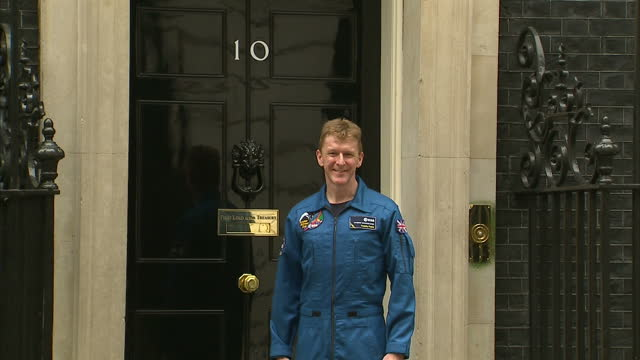 external footage major tim peake, british astronaut, stood in front of number 10 downing street door & walking up stairs w/ david cameron, british... - satellite stock videos & royalty-free footage