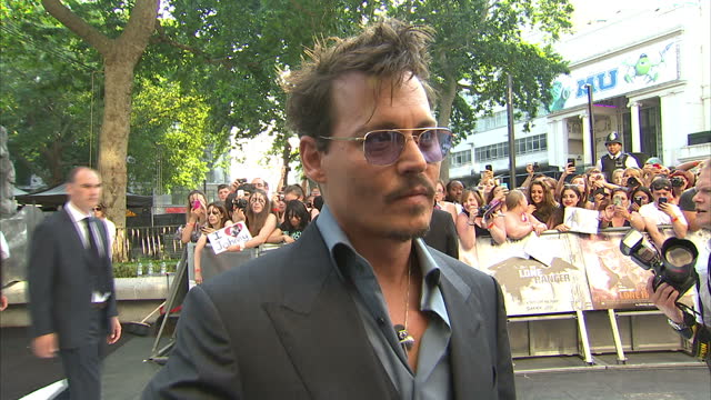 external interview with johnny depp speaking about the challenges of playing tonto lone ranger film premiere in london on july 21 2013 in london... - the lone ranger 2013 film stock videos and b-roll footage