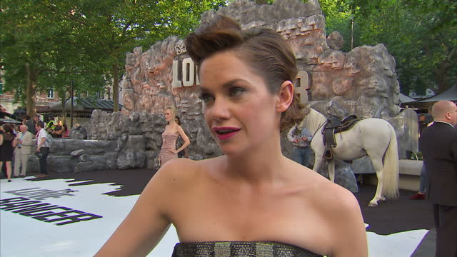 external interview with ruth wilson describing 'the lone ranger' saying 'it's not your run of the mill blockbuster it plays with tone and ideas and... - the lone ranger 2013 film stock videos and b-roll footage