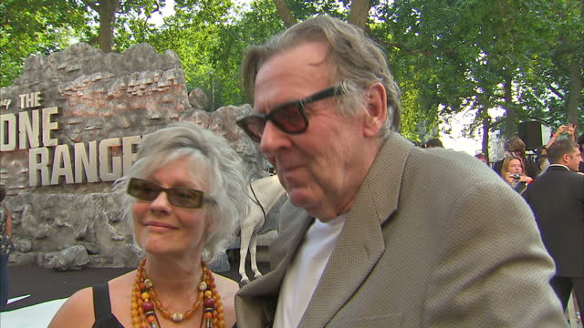 external interview with tom wilkinson speaking about hollywood reinventing classic characters and contrasting the batman films with 'the lone ranger'... - the lone ranger 2013 film stock videos and b-roll footage