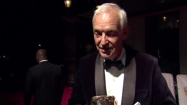 external night interview with news anchor jon snow about being awarded a bafta fellowship at the tv baftas at theatre royal on may 10 2015 in london... - jon snow journalist stock-videos und b-roll-filmmaterial