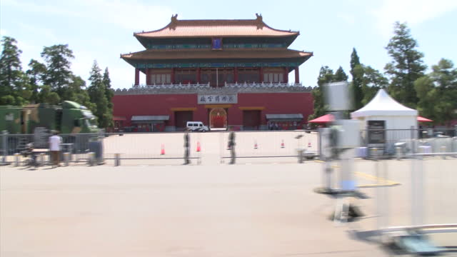 external point of view shots from a moving car of tiananmen square streetscanes beijing china city views motion shot of the iconic beijing tiananmen... - tiananmen gate of heavenly peace stock videos & royalty-free footage