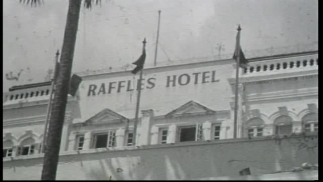 external 'raffles hotel' / traffic streets scenes singapore / vs markets stalls - australian army soldiers bartering at market stalls / street scene... - raffles city stock videos & royalty-free footage