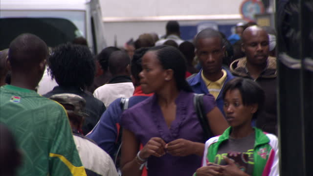 external shot crowds of people walking along pavement in busy shopping district of johannesburg johannesburg cityscape and streetscenes on april 15,... - ハウテング州点の映像素材/bロール