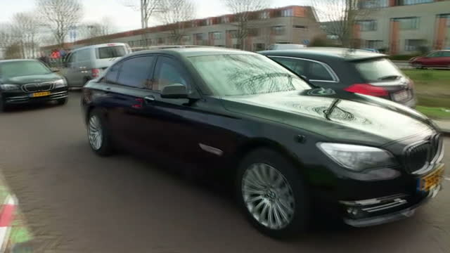 external shot geert wilders founder and leader of the party for freedom in netherlands departing polling station after voting in car surrounded by... - the hague stock videos and b-roll footage