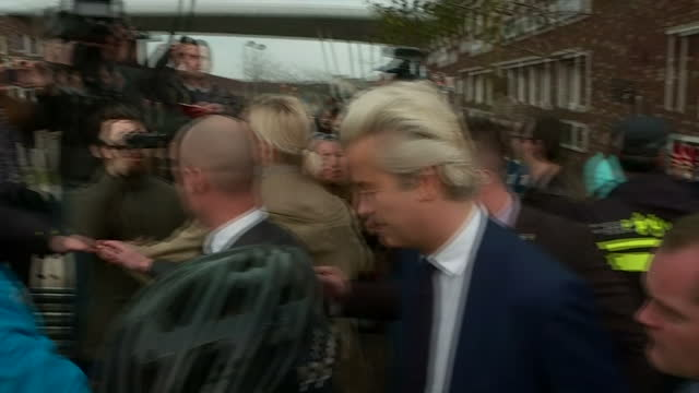 external shot geert wilders founder and leader of the party for freedom in netherlands walks into polling station to vote in the netherlands... - the hague stock videos and b-roll footage