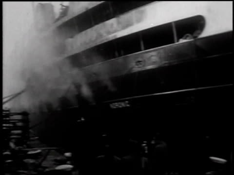 external shot of smoking ship / fire fighters in smoke - 1949 stock videos & royalty-free footage