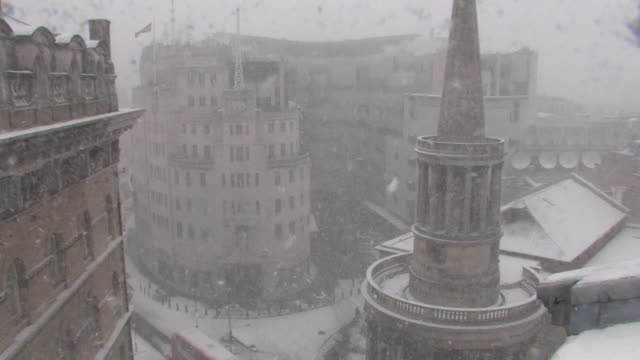 external shot of the bbc's new broadcasting house during a heavy snow blizzard in london, uk - bbc stock videos & royalty-free footage