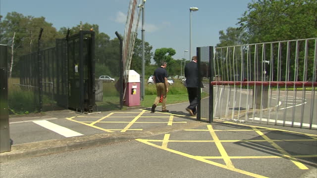 FARNBOROUGH external shots AAIB sign / external shot side of buiding with AAIB in large lettering / exterior shot security gates at entrance /...