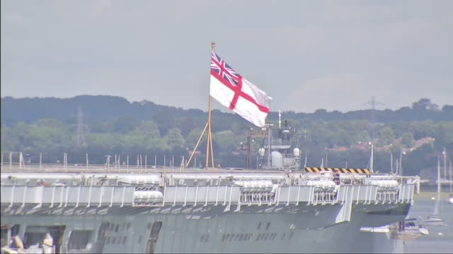 external shots hms illustrious sets sail for cougar 13 includes shots of ship sounding its horn st george's ensign and sailors waving three royal... - hms illustrious r06 stock videos and b-roll footage