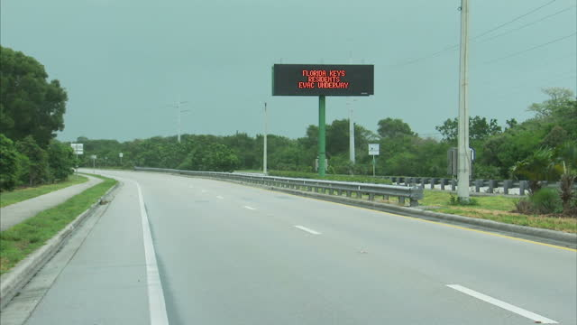 stockvideo's en b-roll-footage met external shots hurricane irma approaching florida keys digital road sign with messages florida keys residents evacuation underway card sound rd tolls... - the florida keys