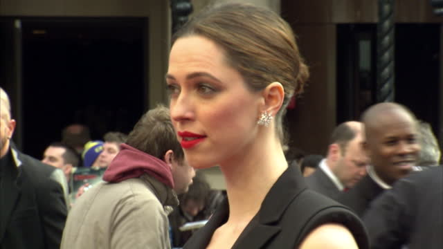 external shots of actress rebecca hall wearing a black lanvin jumpsuit with cut away sides posing on the red carpet at the iron man 3 premiere in... - jumpsuit stock videos and b-roll footage