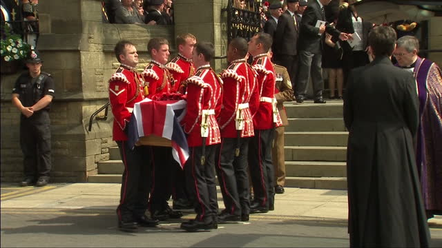 external shots of bearers in ceremonial uniform carrying flag draped coffin of drummer lee rigby out of church to hearse after funeral service in... - lee rigby stock videos & royalty-free footage