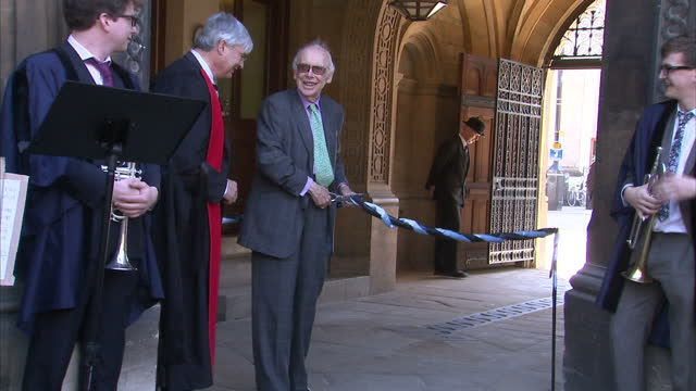 external shots of biologist james watson cutting ceremonial rope at ceremony commemorating fellow dna pioneer francis crick at gonville and caius... - francis crick stock videos & royalty-free footage