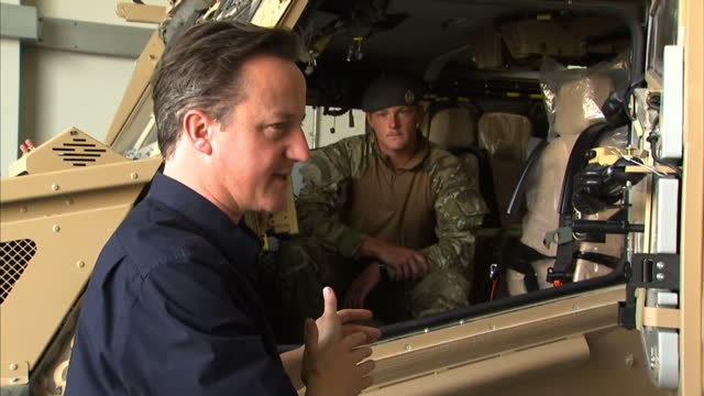 external shots of david cameron being shown around a foxhound armoured vehicle force protection ocelot, and speaking with soldiers. david cameron... - foxhound stock videos & royalty-free footage