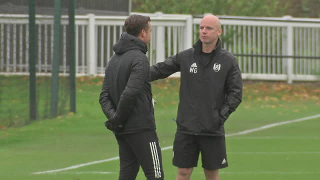external shots of fulham manager scott parker talking to fulham physio wayne gill during a training session. - physiotherapy stock videos & royalty-free footage