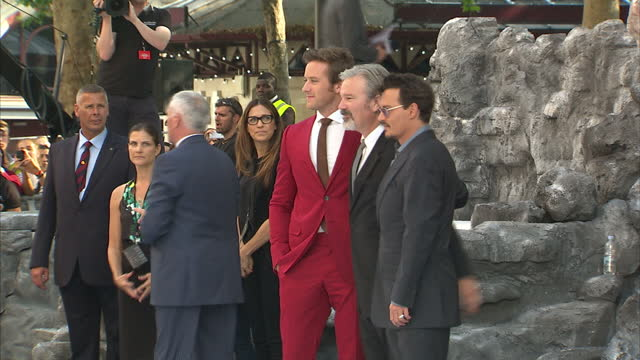 external shots of johnny depp armie hammer and gore verbinski talking and posing for photo opportunity on the black and white carpet lone ranger film... - the lone ranger 2013 film stock videos and b-roll footage
