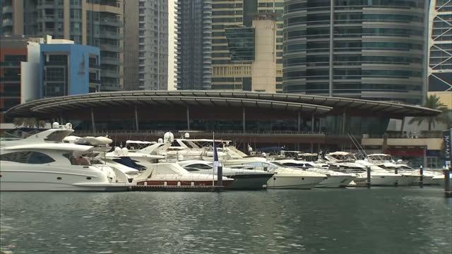 External shots of luxury yachts docked at the Dubai Marina Yacht Club Dubai Stockshots on April 28 2013 in Dubai United Arab Emirates