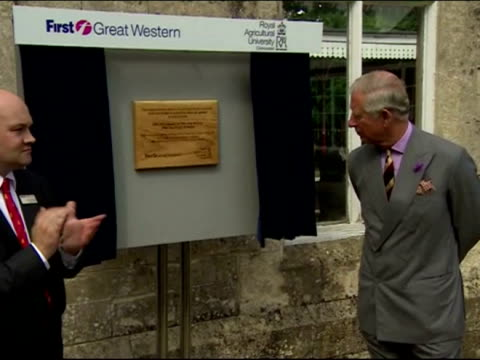 External shots of Prince Charles unveiling a wooden plaque commemorating his official opening of the newly redesigned Kemble station gardens Prince...