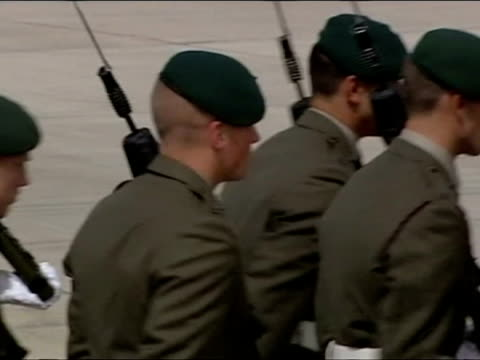 external shots of prince harry watching from podium and saluting as troops from 1 assault squadron, royal marines march on parade prince harry... - 英国海兵隊点の映像素材/bロール