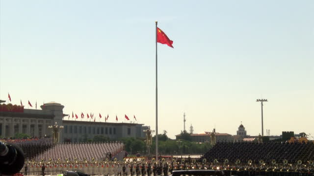 external shots of red chinese flags at a military army parade in tiananmen square beijing china to mark the defeat of japan in world war two ww2... - military parade stock videos & royalty-free footage
