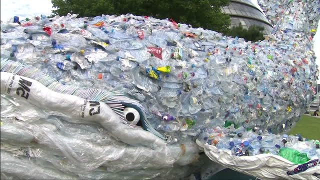 stockvideo's en b-roll-footage met external shots of tenmetre plastic whale made of 250 kilograms of singleuse plastic close up shots of used empty plastic bottles straws etc and other... - cetacea