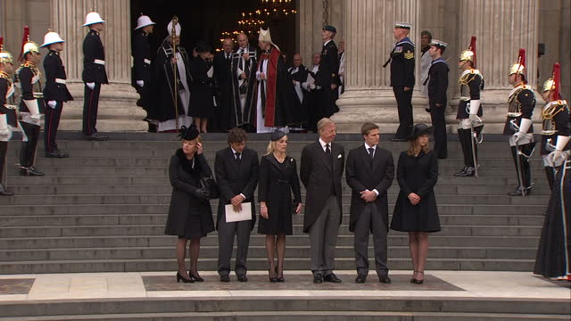 External shots of the flagdraped coffin of Baroness Thatcher being placed in hearse outside St Paul's Cathedral as the Thatcher family watch...