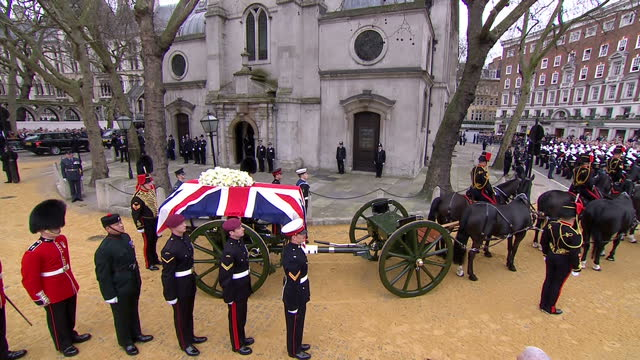 external shots of the funeral procession for baroness thatcher with union flagdraped coffin being carried on a gun carriage by the royal horse... - royal horse artillery stock videos and b-roll footage