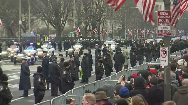 External shots of the presidential motorcade carrying Donald Trump and Barack Obama drives towards the US Capitol ahead of inauguration ceremony...