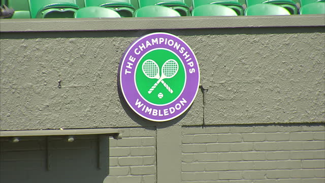 external shots of wimbledon centre court w/ sign reading 'the championships wimbledon' and scoreboard displaying scores from 2012 wimbledon... - scoreboard stock videos & royalty-free footage