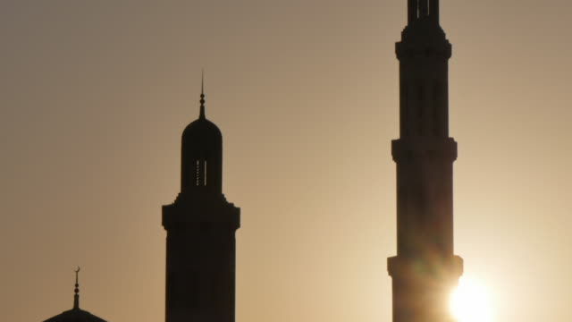 External views of the Sultan Taboos Grand Mosque at sunset, Muscat, Oman, Middle East, Asia