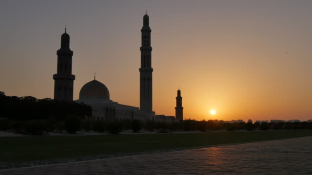 external views of the sultan taboos grand mosque at sunset, muscat, oman, middle east, asia - sultan stock videos and b-roll footage