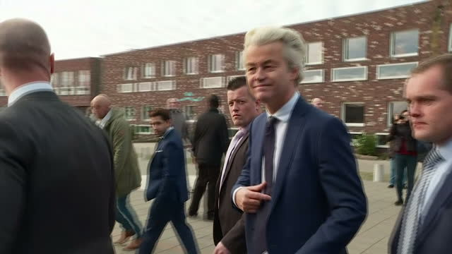 external wide side shot geert wilders founder and leader of the party for freedom in netherlands walking out after voting in the netherlands... - the hague stock videos and b-roll footage