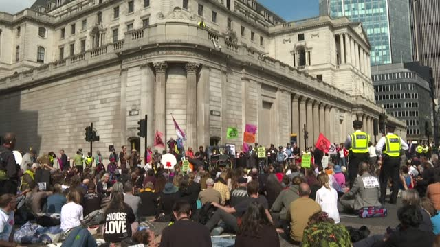 extinction rebellion block roads outside bank of england in london - report produced segment stock videos & royalty-free footage