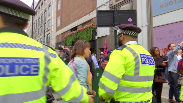 extinction rebellion blocks busy london junction as new campaign begins; england: london: trafalgar square: various of extinction rebellion... - road stock videos & royalty-free footage