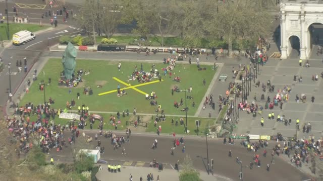 Extinction Rebellion climate change protesters block roads in London ENGLAND London shots of protesters at Marble Arch Hyde Park Corner Waterloo...